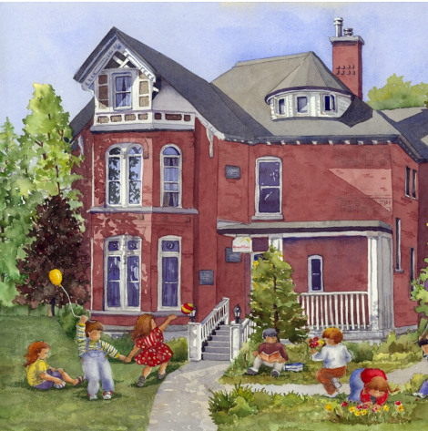 A red brick house with children playing in the yard.